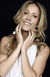 Sheryl Crow, good looking? sure but she's another green Idiot...